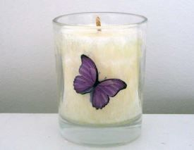 Candle and holder with butterfly